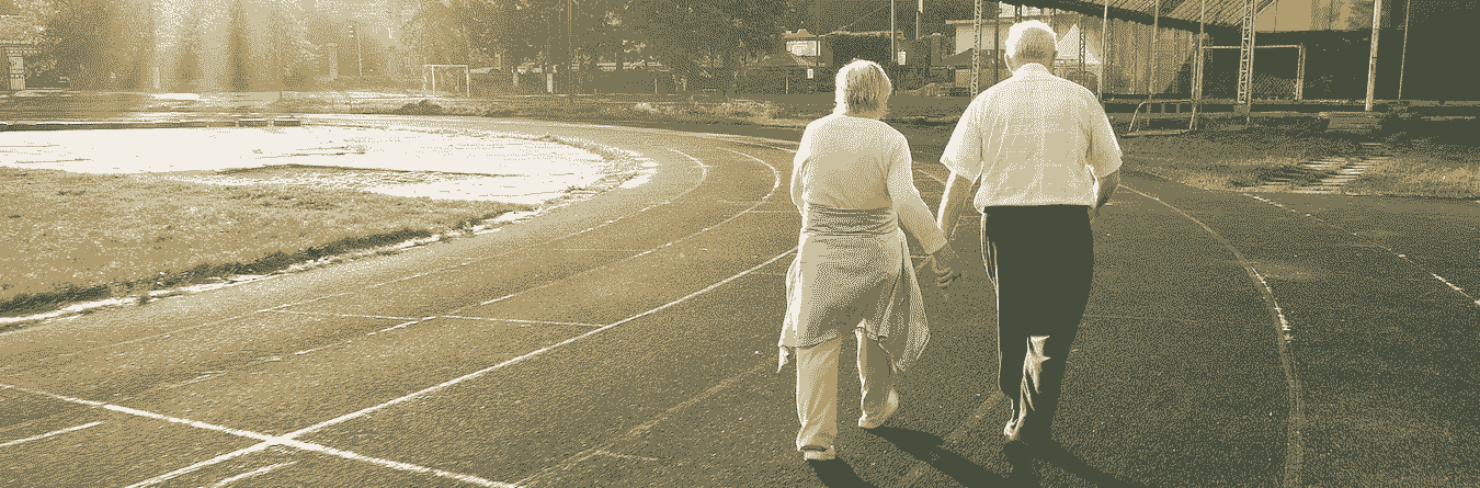 senior couple walking on track