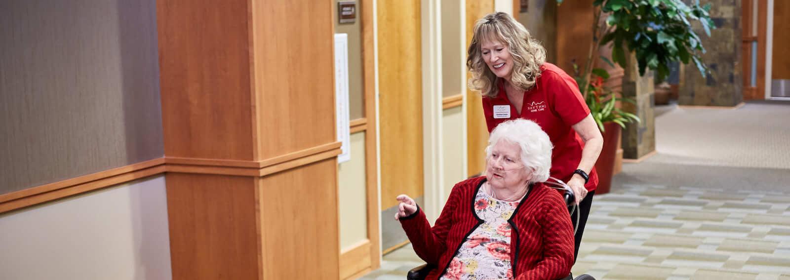 caregiver pushing wheelchair