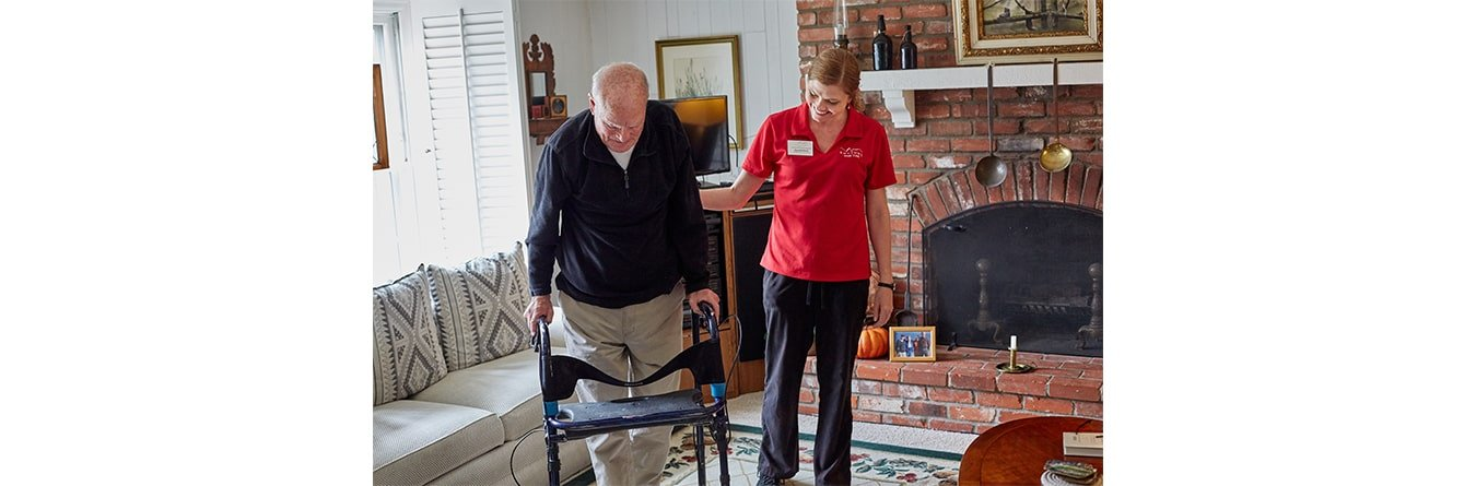 rhythms home caregiver helping elderly man