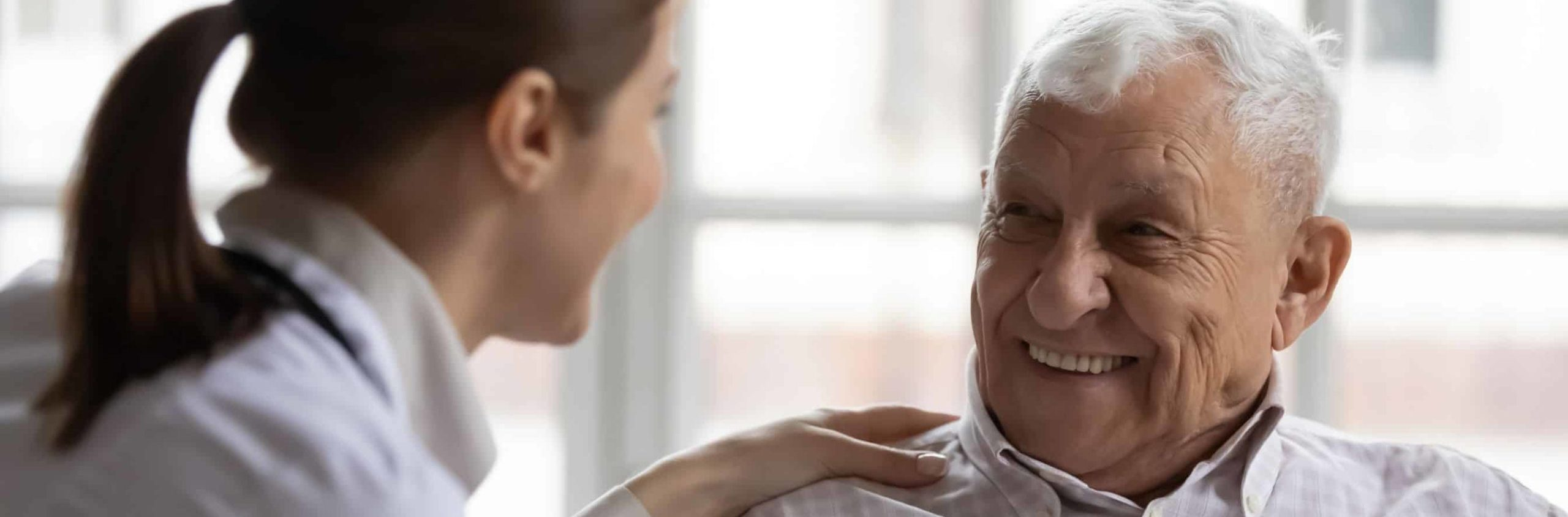 Nurse treating elderly man